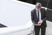 Businessman using digital tablet — Stock Photo