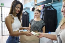 Customer paying for purchase in fashion boutique — Stock Photo