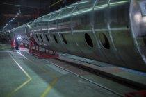 Man welding large steel tank in factory — Stock Photo