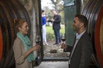 Confident people tasting wine at wine estate — Stock Photo