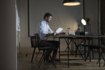 Serious Businessman working late in office — Stock Photo
