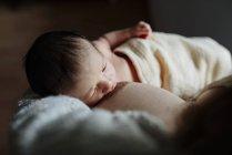 Close-up of Mother breastfeeding newborn baby — Stock Photo