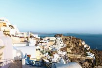 Greece, Santorini, Oia, village at evening twilight with tourists waiting for sunset — Stock Photo