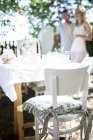 Garden chair with cushion and couple on background — Stock Photo
