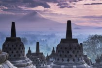 Indonesia, Central Java, Magelang, Candi Borobudur and Mount Merapi — Stock Photo