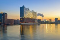 Germany, Hamburg, lighted Elbe Philharmonic Hall at morning twilight — Stock Photo