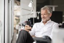 Businessman using cell phone — Stock Photo