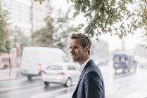 Germany, Berlin, portrait of smiling businessman — Stock Photo