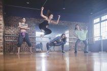 Female hip hop dancers performing in studio — Stock Photo
