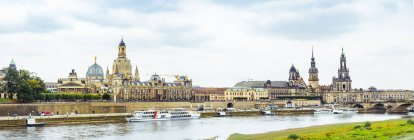 Germany, Saxony, Dresden, historic old town with Elbe River in the foreground — Stock Photo