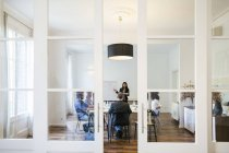 Business people having a team meeting behind glass doors — Stock Photo