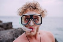 Portrait of young man in diving goggles with snorkel — Stock Photo