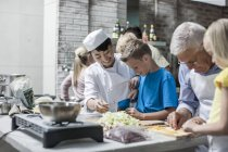 Chef cooking class with happy kids — Stock Photo