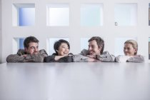 New York city office, four people standing in a row in office — Stock Photo