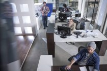 Top view of staff working at desk — Stock Photo