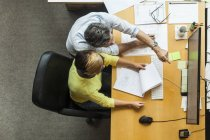 Male and female architects discussing work in office — Stock Photo