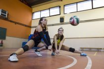 Two volleyball players digging the ball during a volleyball match — Stock Photo