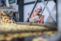 Female inspector in food processing plant — Stock Photo