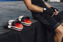 Caucasian boxer sitting at boxing ring — Stock Photo