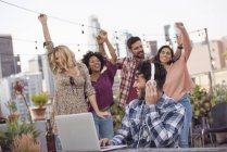 Friends dancing at rooftop party, Los Angeles, USA — Stock Photo