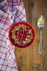Bowl of granola with pomegranate seed — Stock Photo