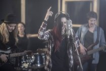 Female rock band in recording studio — Stock Photo