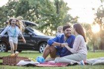 Happy having picnic at road trip — Stock Photo