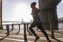 USA, New York City, man running at East River — Stock Photo