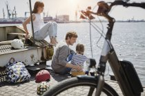 Portrait of family sitting on pier of Elbe river — Stock Photo
