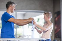 Father and son, how to iron properly — Stock Photo