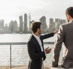 Businessmen discussing at East River, New York City, USA — Stock Photo