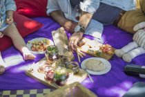 Family picnic with food and snacks — Stock Photo