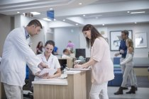 Medical staff standing in reception area in hospital — Stock Photo