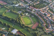 Germany, arial view of Hildesheim town with sports-field — Stock Photo