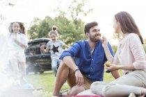 Happy family having a picnic at road trip — Stock Photo