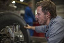 Factory worker in industrial truck manufacture — Stock Photo