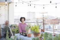 Woman on rooftop gardening, Los Angeles, USA — Stock Photo