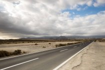 Spain, Tenerife, Empty driveway with cloudy sky on background — Stock Photo