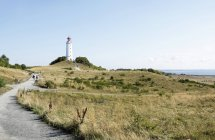 Germany, Hiddensee, Dornbusch, view to landscape and lighthouse — Stock Photo