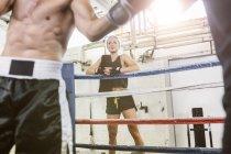 Caucasian woman watching boxing match — Stock Photo