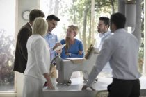 Young people working together in modern office — Stock Photo