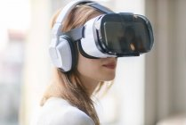Woman wearing Virtual Reality Glasses and headphones — Stock Photo
