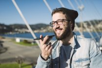 Portrait of a casual young man using smartphone, Ferrol, Galicia, Spain — Stock Photo