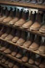 Unfinished shoes on shelf in cobbler's workshop — Stock Photo