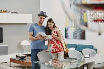Portrait of couple looking at catalog in furniture store — Stock Photo