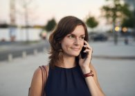 Germany, Hamburg, Young businesswoman talking on the phone — Stock Photo