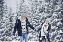 Happy couple in winter landscape — Stock Photo