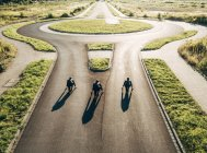 Three businessmen starting race at roundabout — Stock Photo