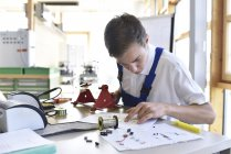 Student assembling circuit board — Stock Photo