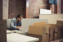 Desperate businessman working in office — Stock Photo